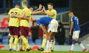 Everton's goal scorer Dominic Calvert-Lewin looks dejectected as the Burnley players celebrate their win.