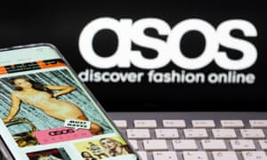 Smartphone with an ASOS app and a keyboard are seen in front of a displayed ASOS logo in this illustration picture taken October 13, 2020.