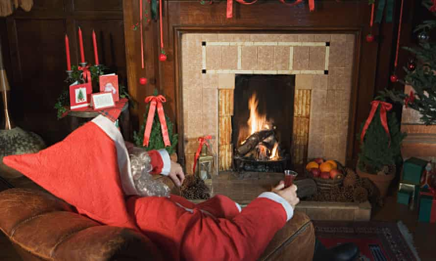 Santa claus drinking sherry by the fire