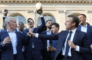 France's coach Didier Deschamps (L) speaks next to French President Emmanuel Macron (R) during a reception at the Elysee Presidential Palace in Paris