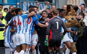 Huddersfield Town manager David Wagner celebrates with his players after Tom Ince scored the winner in injury time and moved them seven points clear of the Premier League relegation zone.