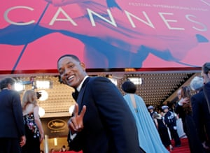 """Opening ceremony and screening of the film """"Les fantomes d'Ismael"""" (Ismael's Ghosts) Red Carpet Arrivals Jury member Will Smith poses."""