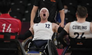 Britain's Aaron Phipps (13) celebrates after Britain defeated Japan in a semifinal wheelchair rugby match.