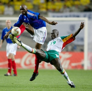 Patrick Vieira of France challenges for the ball with Papa Bouba Diop of Senegal during their group stage match which Senegal won 1-0