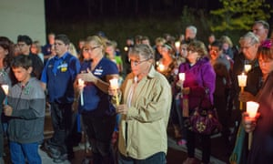 Mourners hold candles during a vigil for victims of the Roseburg shooting.