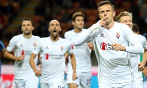 Fiorentina's Josip Ilicic celebrates after scoring the opening goal from the penalty spot during the Serie A match against Inter.