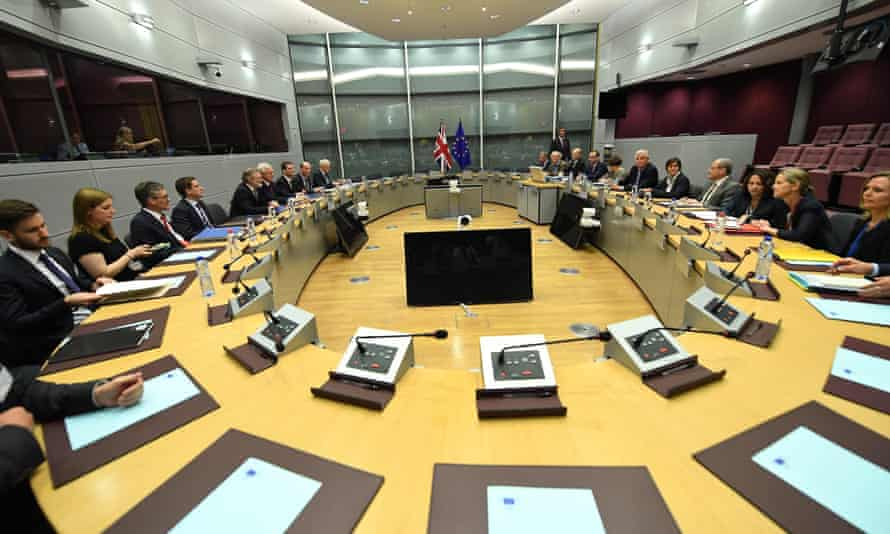 The British negotiating team (left) meet their EU counterparts in Brussels.