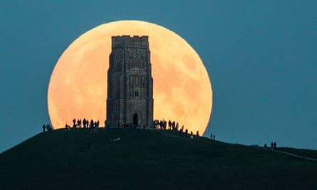 A lunar eclipse behind Glastonbury Tor in 2015.