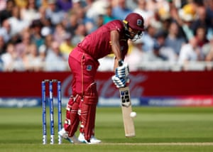 Nicholas Pooran drives a shot for four.