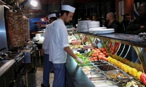Behind the counter shot of chefs at work at Ranoush Juice, London