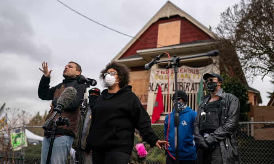 The Kinney family and activists outside the Red House in Portland. Michael Kinney said: 'It's a fight against systemic racism and gentrification that's been going on for years.'