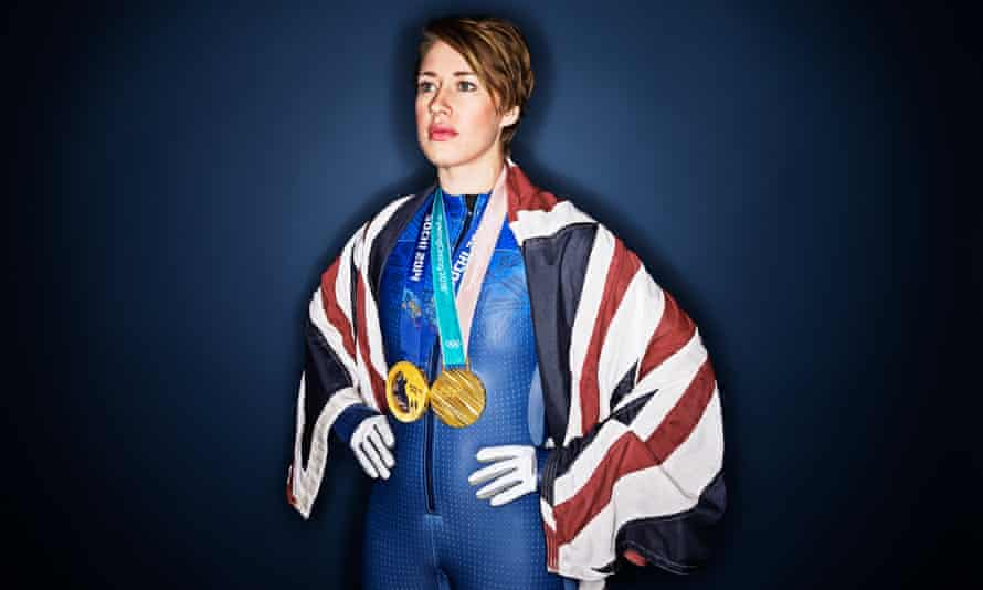 Lizzy Yarnold poses with her Olympic gold medals won at Sochi and Pyeongchang.