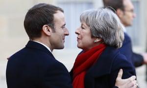 Theresa May is welcomed by Emmanuel Macron in Paris in December.