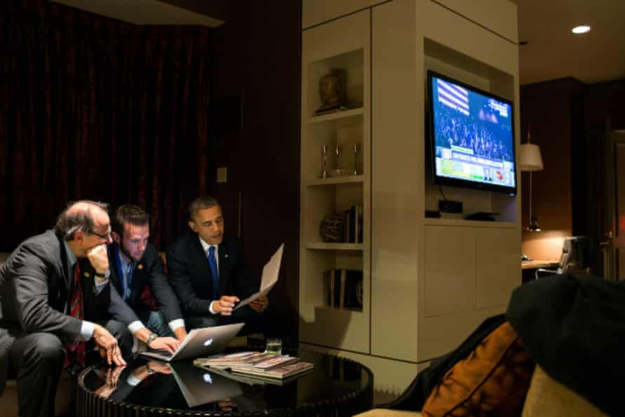 Pod Save America co-host Jon Favreau, centre, in his White House days with David Axelrod and Barack Obama.