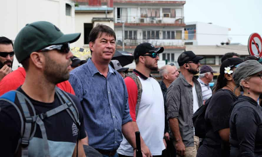The government of president Thierry Santa has collapsed in New Caledonia on the question of independence from France. Pictured here (second from left), Santa marches with a loyalist coalition in Noumea.