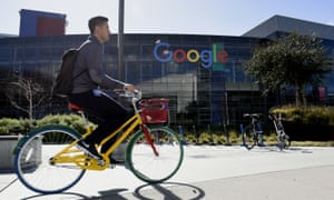 A cyclist rides past Google offices in Mountain View, California. Google would have been among the companies facing the tax.
