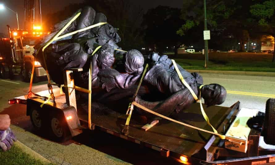 A monument dedicated to the Confederate Women of Maryland lies on a flatbed trailer near the intersection of Charles Street and University Parkway early Wednesday morning, after it was taken down.