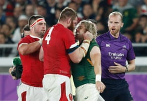 South Africa's Faf de Klerk clashes with Wales' Jake Ball.