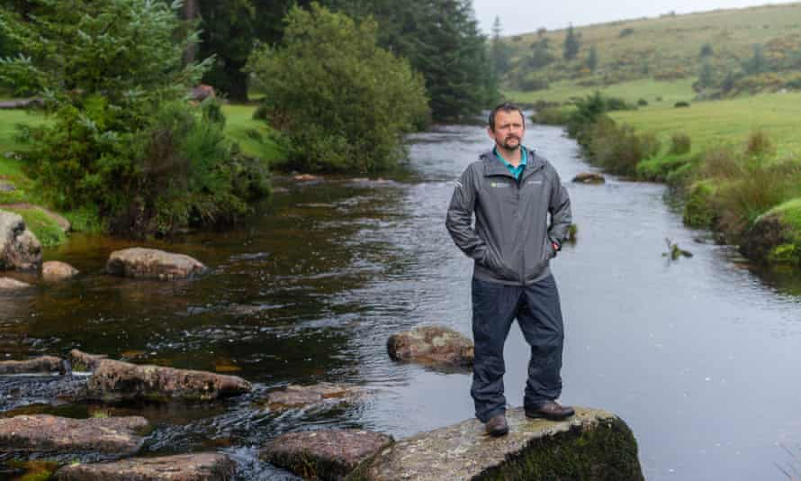 Simon Lee standing on rock in river