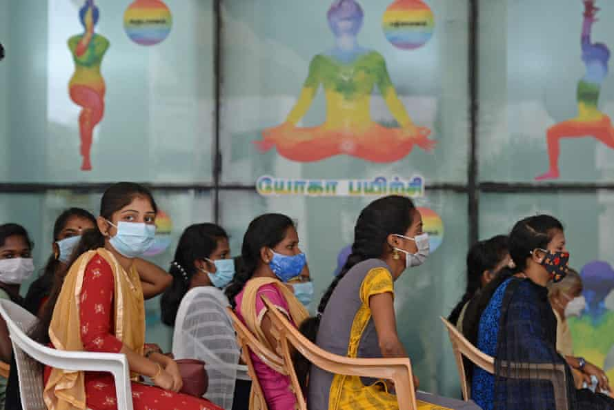Indian frontline workers wait to be inoculated with the Covid-19 coronavirus vaccine at a government hospital in Chennai.