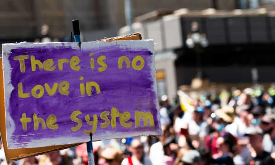 A placard at a Melbourne lockdown protest, saying: 'There is no love in the system'