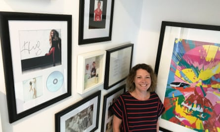 Di Coke in her hallway of signed prints.