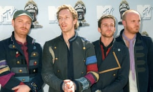 Coldplay and Guy Berryman (third from left).