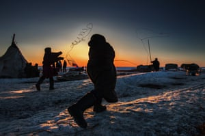 Reindeer herder tries to do Lasso throwing at Nomad camp