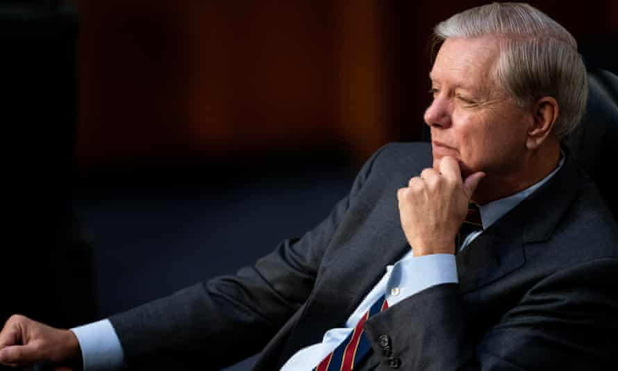 Committee chairman Lindsey Graham listens.