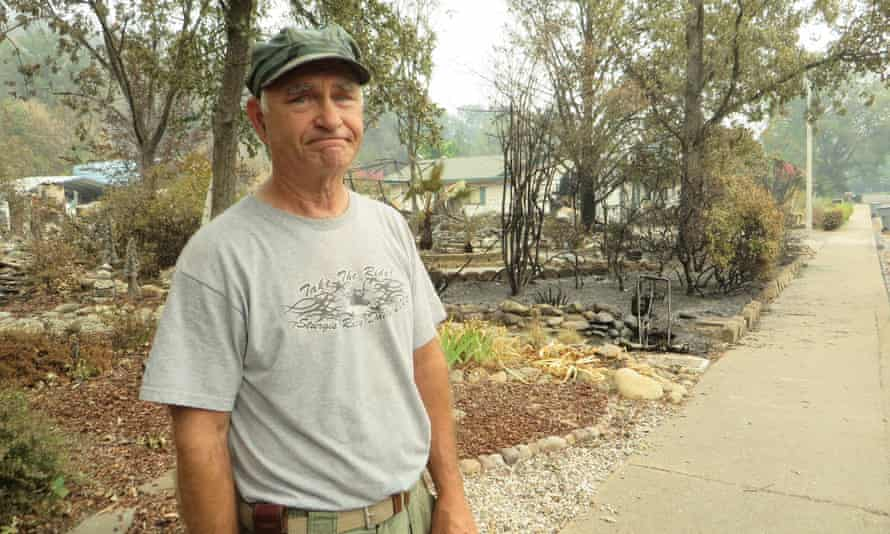 Roger Gray standing in front of his neighbor's yard in Redding, California.