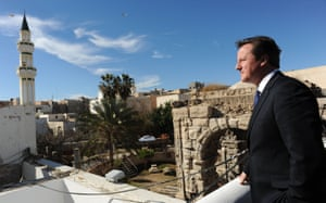 Cameron looks out over Tripoli during a visit to Libya in 2013.