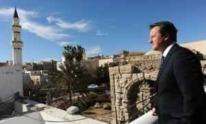 Cameron looks out over Tripoli during his visit to Libya in 2013.