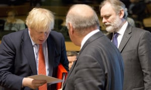 Boris Johnson (left) receives an envelope from Malta's foreign minister George Vella (centre) during a meeting of EU foreign ministers in Luxembourg this morning. Standing on the right is the UK permanent representative to the EU, SirTim Barrow.