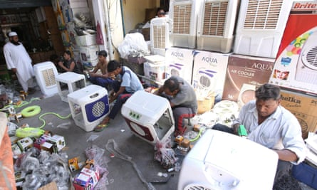 Workers assemble air coolers for sale as the temperature rises in New Delhi