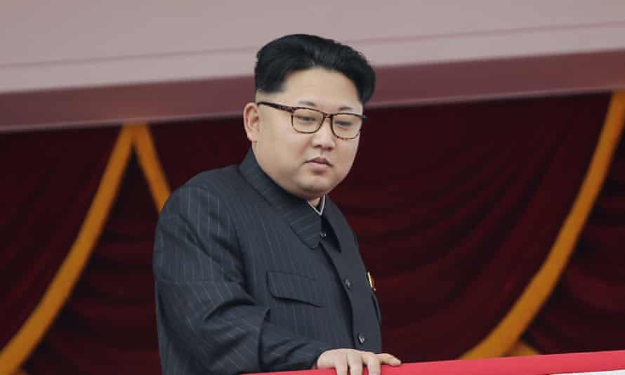 North Korea's leader Kim Jong-un watches a parade from a balcony at the Kim Il Sung Square.