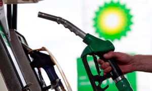A customer holds a pump at a BP petrol station in London
