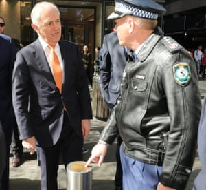 Prime minister Malcolm Turnbull talks to NSW police commissioner Mick Fuller during a walk out at Pitt Street Mall in Sydney, 20 August 20 2017.