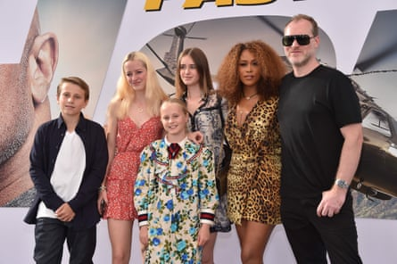 Eve with husband Maximillion Cooper and his children.