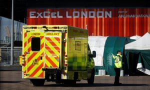 An ambulance outside the ExCel centre, London, which is being prepared to become the NHS Nightingale hospital