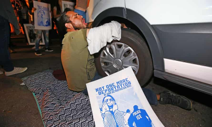 A protester locks himself to the van carrying Guadalupe Garcia de Rayos outside the Ice facility in Phoenix.