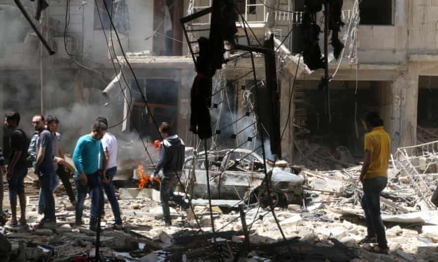 The aftermath of an airstrike in a rebel-held area of Aleppo on Thursday