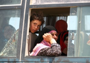 Buses take fleeing families to relative safety away from the frontlines