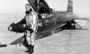 Astronaut Neil Armstrong with an X-15 rocket plane after a test flight