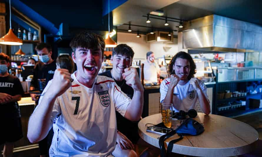 England fans in a Falmouth pub celebrate their team scoring in the first Euro 2020 match against Croatia.