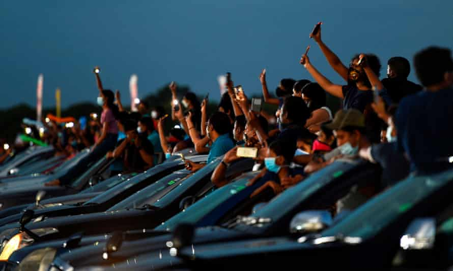 Lovebox to glovebox: Concertgoers attend a drive-in show at an an airport in Colombo, Sri Lanka