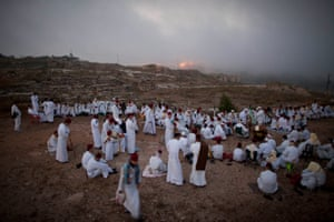 Members of the Ancient Samaritan community pray during a pilgrimage marking the end of the holy day of Shavuot. The pilgrimage took place at the religion's holiest site on Mount Gerizim, near the West Bank town of Nablus.