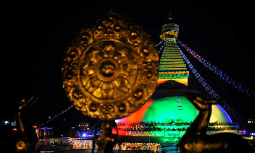 An illuminated view of Boudhanath stupa during the purification ritual.
