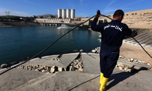 An employee works at strengthening the Mosul Dam on the Tigris River
