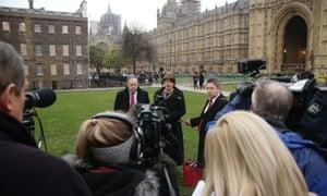 DUP leader Arlene Foster and deputy leader Nigel Dodds speak to the media in Westminster.