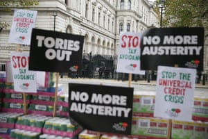 London, UKCampaigners protest against government austerity programmes next to crates of tinned food destined for food banks outside Downing street
